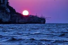 Peschici, Apulia, Gargano, Italy: Adriatic sea coast at sunset with an ancient fishing hut trabocco Stock Photo