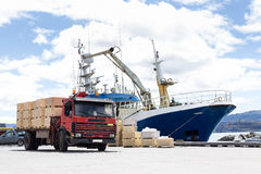 Trabsportation ship and truck with blue sky. Royalty Free Stock Photography