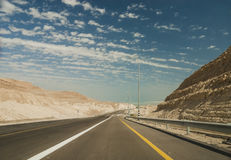 Trac driving on desert road. Royalty Free Stock Photo