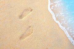 Tracce dell'essere umano sulla sabbia Immagine Stock