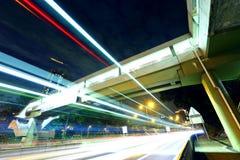 Tracce dell'indicatore luminoso della strada principale Fotografia Stock