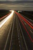 Tracce dell'indicatore luminoso della strada principale Immagine Stock