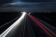 Tracce della luce della strada principale di inverno Fotografia Stock Libera da Diritti