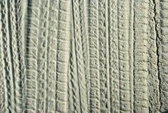 Tracce delle protezioni sulla sabbia Fotografia Stock Libera da Diritti