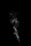 Traccia del fumo isolata sul nero Immagini Stock Libere da Diritti