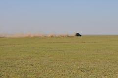 Traccia della polvere attraverso la Tanzania Immagini Stock