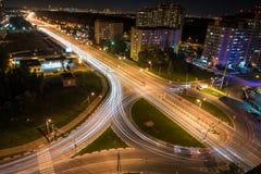 Traccia delle luci su una strada principale Immagini Stock