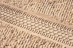 Traccia di rotelle sulla sabbia Fotografie Stock Libere da Diritti