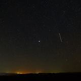 Trace of aircraft in the night sky Royalty Free Stock Photography