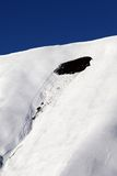 Trace of avalanche on off piste slope in sun day. Close-up view. Royalty Free Stock Images