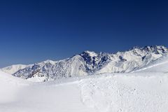 Trace of avalanche on snow slope Stock Images