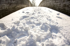 Trace on the bridge. Snow over the bridge in a sunny day Stock Photography