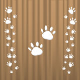 Trace cats. Traces of cats on a brown background Royalty Free Stock Photo