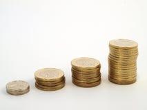 Trace el crecimiento de las monedas Imágenes de archivo libres de regalías