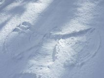 Trace figure of a people in the snow. Royalty Free Stock Photo