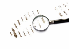 Trace from footwear with magnifying glass Stock Photo