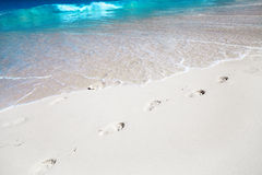 Trace of a human foot on sand Royalty Free Stock Images