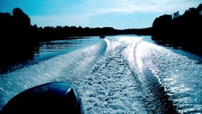 Trace of motor boat on the water stock footage