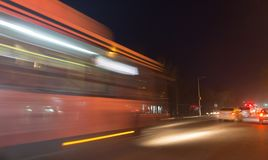 The trace of a moving bus at night.  Stock Images