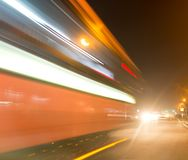 The trace of a moving bus at night.  Royalty Free Stock Photos
