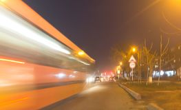 The trace of a moving bus at night.  Stock Photography