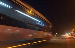The trace of a moving bus at night.  Stock Photo