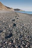 Trace on the pebble beach. Human trace on the pebble beach Stock Photos