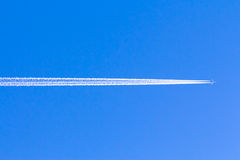 Trace of the plane in the blue sky Stock Photos