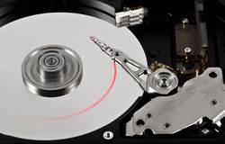 Trace of reading information. Close-up of the opened Hard Disk Drive. Red trace information from reading Stock Images