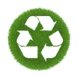 Trace of recycling on the green grass in the form Stock Photo