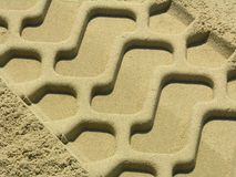 Trace in the sand. The trace of a tyre in the sand on the beach Stock Photography