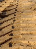 Trace the sand. Deep clear trail left by the tractor on the sand on a sunny autumn day Stock Photo