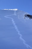 Trace from ski on off-piste slope in early morning Royalty Free Stock Photos