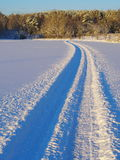 Trace of a snowmobile. Crossing a snow-covered lake under the ice cover Royalty Free Stock Photography