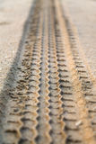 Trace of tire in sand Stock Photo