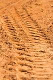 trace of a tyre in the sand Stock Images