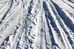 Trace of wheels on winter road. For background Royalty Free Stock Photo