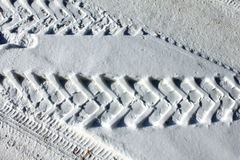 Trace of wheels on winter road. For background Stock Photo