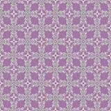 Tracery decor. Abstract  tracery regular  decor on a purple square background Royalty Free Stock Photos