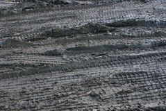Traces. Traces on the dirty earth of heavy wheel transport Stock Image