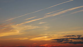 Traces of the aircraft at sunset stock video footage