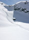 Traces in alpine fresh snow Stock Images