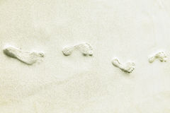 Traces of bare feet in the sand on a tropical island Royalty Free Stock Images