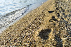 Traces on a beach. Footprints on a mediterranean beach royalty free stock photo