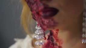 Traces of blood on the neck and the camera translation disfigured face. Macro image of all the details for the dead bride makeup (Blood on the neck, face stock footage