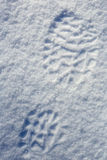 Traces from boots on snow, background Royalty Free Stock Photos