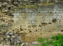 Traces of bullets on fortress wall Royalty Free Stock Photography