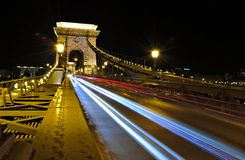 Traces of car headlights across the bridge Royalty Free Stock Images