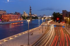 Traces of car headlights moving cars. Evening view of the embankment of the Moscow River. Traces of car headlights moving cars. Evening view of Moscow street stock photography