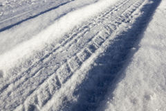 Traces of the car on snow Royalty Free Stock Images